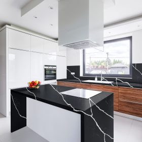 Modern, white kitchen with island and long countertop